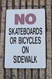 Bicycles Prohibited sign. Sign prohibiting use of sidewalk for skateboards and bicycles Royalty Free Stock Photography