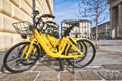 Bicycles in public use in the city.  Stock Images