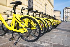 Bicycles in public use in the city.  Royalty Free Stock Photo