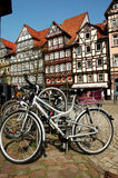 Bicycles in rack. In the town square of German village royalty free stock images