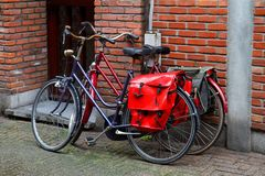 Bicycles with red bags on the trunk. stock images
