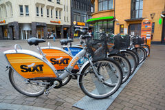 Bicycles for rent parking at daytime Royalty Free Stock Images