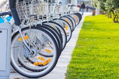 Bicycles for rent in public park stock photos