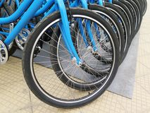 Bicycles for rent stand in a row Stock Photo