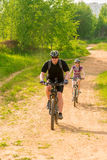 Bicycles ride on a country road Royalty Free Stock Photography