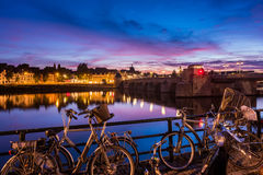 Bicycles at River Maas in Maastricht Netherlands. Around dusk on summer evening stock photography