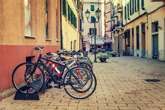 Bicycles in a row on the street of Ventimiglia. Stock Images