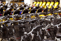 Bicycles and scooter bikes rows in a renting shop. Pattern Royalty Free Stock Photo