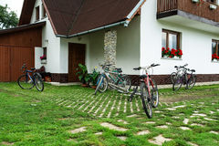 Bicycles. Several bicycles standing in front of the house Stock Photo