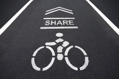 Bicycles sign. Sign on the cycling way meaning please share bike lanes for bikers.bicycles sign in the park Stock Photo