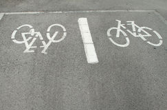 Bicycles sign in the ground Stock Photo