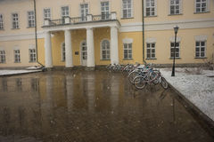 Bicycles smoothly covered with fresh snow after weather phenomen Royalty Free Stock Photography