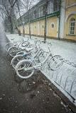 Bicycles smoothly covered with fresh snow after weather phenomen Royalty Free Stock Photos