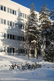 Bicycles in snow. Parked bicycles in winter morning sunlight, Tampere, Finland Stock Image