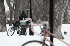 Bicycles in snow Stock Photo