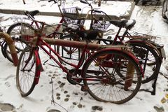 Bicycles on a snowy sidewalk Stock Image