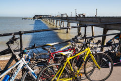 Bicycles stacked at the end of Deal Pier, Kent. Royalty Free Stock Photo