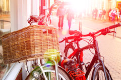 Bicycles  stand near wall on the street in Dutch city Stock Photos