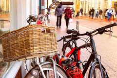 Bicycles  stand near wall on the street in Dutch city Royalty Free Stock Photo