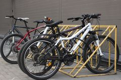 Bicycles stand in the parking lot, front view royalty free stock photos