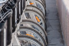 Bicycles standing in the paid parking lot gray royalty free stock images