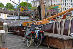 Bicycles standing on the quay near the exhibits of the Netherlan Royalty Free Stock Photography