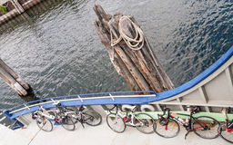 Bicycles stored on ferry boat Stock Photos