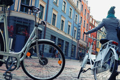 Bicycles on the street of the old town Riga in early spring Royalty Free Stock Photos