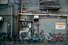 Bicycles on the street of Shinjuku, Japan. Shinjuku is a city located in Tokyo. The station is the busiest one in the world. This is taken in the summer time stock photography