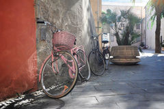 Bicycles on sunny street. Bicycles on a sunny street in Finalborgo, an Italian medieval town on the Ligurian coast Stock Images