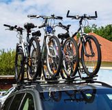 Bicycles on the top of a car Stock Images