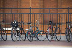 Bicycles at the train station Stock Photography