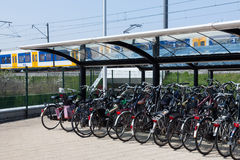 Bikes at the trainstation. SASSENHEIM, THE NETHERLANDS, APRIL 24, 2015 - Bicycle parking at the trainstation in Sassenheim Royalty Free Stock Photo