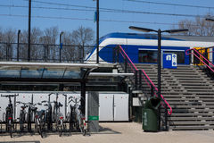 Bikes at the trainstation. SASSENHEIM, THE NETHERLANDS, APRIL 24, 2015 - Bicycle parking at the trainstation in Sassenheim Stock Photo