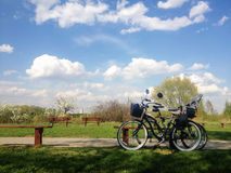Bicycles. Two bicycles near bench and beautiful sky Royalty Free Stock Images