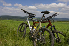 Bicycles. Two bicycles are resting on the road stock images