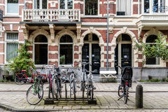 Bicycles and typical houses in Oude Pijp Royalty Free Stock Photos