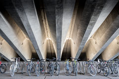 Bicycles under concrete beams Royalty Free Stock Photos
