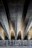 Bicycles under concrete beams Stock Photos