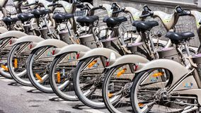 Bicycles of the Velib bike rental service. Paris, France. Paris, France - June 16, 2017: Some bicycles of the Velib bike rental service. With the bicing sharing royalty free stock image
