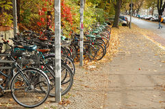 Bicycles waiting nearby railway station Royalty Free Stock Photos