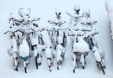Bicycles winter snow covered. Many Bicycles winter snow covered Stock Photography
