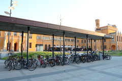 Bicycles at Wroclaw main railway station building at sunset. Stock Photography