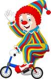 Bicyclette d'équitation de clown de bande dessinée Image stock