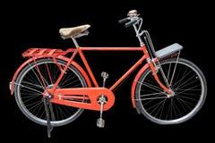 Bicyclette rouge de vintage d'isolement sur le noir Enregistré avec le chemin de coupure Photo stock