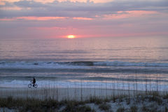 Bicycling on the Beach at the Blush of Dawn Stock Image