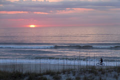 Bicycling On the Beach At Daybreak Royalty Free Stock Photos