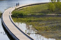 Bicycling on boardwalk Royalty Free Stock Photography