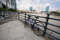Bicycling on the Boat Quay in Singapore Stock Photography
