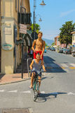 Bicycling boys on the street of small town Vada, Italy Royalty Free Stock Photography